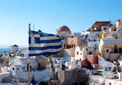 The flag of Greece - Houses of Oia as backdrop