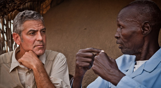NOOW-Charity-Page_George-Clooney-talks-with-a-man-who-was-displaced-during-clashes-in-Abyei-in-2008.-681x374