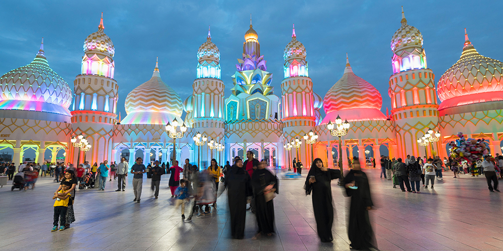 F7CGKB Evening view of illuminated Gate of the World at Global Village 2015 in Dubai United Arab Emirates
