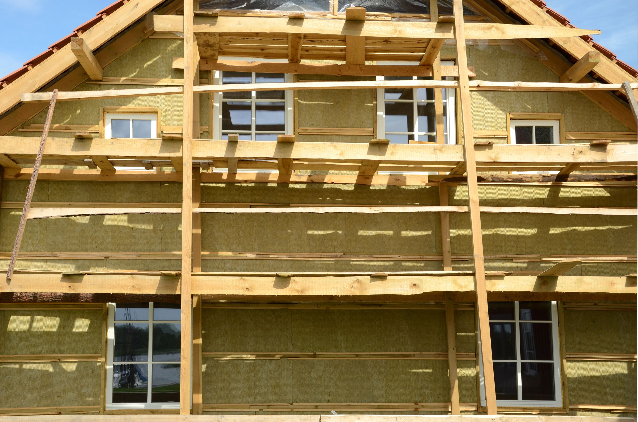 18213092 - new wooden house  exterior thermal insulation with mineral rockwool